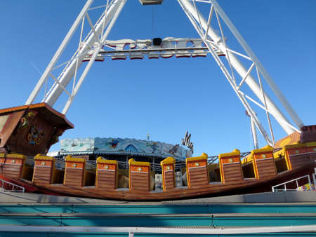 Orchard Beach, Maine - June 3, 2014:  Pirate Ship at Palace Playland, which is a Compact, beachfront amusement park with a Ferris wheel, roller coaster & more, plus a large arcade. Sajtókép