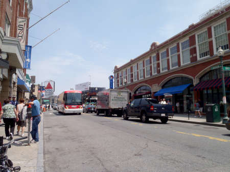 Boston - June 2, 2010: Bus and Trucks drive along Brookline ave with Citgo sign in the distance. Stock Photo - 133369064