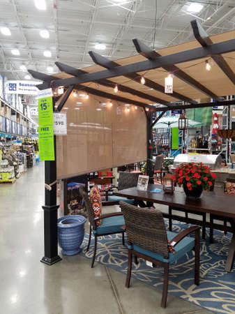 Honolulu - June 20, 2017: Outdoor Furniture including chairs, table, flowers , and Gazebo For Sale Inside Lowe's Home Improvement store.