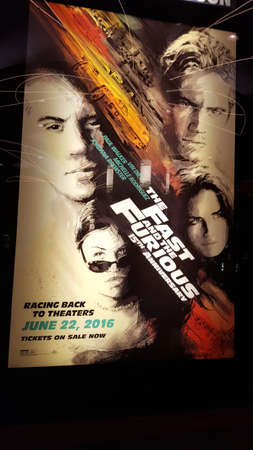 Honolulu - June 6, 2016: The Fast and the Furious 15th Anniversary Movie Poster at Regal Movie Theater in Honolulu, Hawaii.  The Fast and the Furious (colloquial: Fast & Furious) is an American media franchise centered on a series of action films that is
