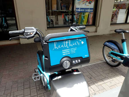Honolulu - June 29, 2017: Close-up of Biki Bikeshare on Fort Street Mall in front of Fisher Hawaii.  Biki is Honolulu's new transportation system, brought to you by Bikeshare Hawaii. Launched in late June 2017, Biki has 1,000 bikes at 100 conveniently l