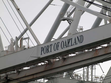 Oakland - July 21, 2010:  Close up of large shipping crane featuring Port of Oakland Sign.  The gateway to US commerce, the Port is located on the Oakland waterfront and is host to Oaklands tourism, estuaries and waterfront parks, as well as, maritime ac