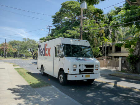 Waikiki - July 12, 2018: FedEx Delivery Truck parked in street in Waikiki.  FedEx Corporation is an American multinational courier delivery services company headquartered in Memphis, Tennessee.