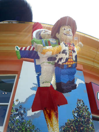 California - July 23, 2012: Lego Toy Story Characters Buzz Lightyear and Woody blasting off in display in front of Lego Store. 新聞圖片
