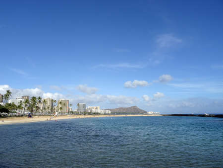 Beach on Magic Island in Ala Moana Beach Park on the island of Oahu, Hawaii.  On a beautiful day with Diamond Head and Waikiki in the distance.