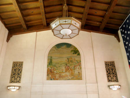 San Jose, California - August 5, 2010: Mural on Wall inside San Jose Diridon Station. behind the ticket counter by John MacQuarrie portrays San Jose as it appeared in 1935, with the Lick Observatory and a train in the background also was cleaned and resto Sajtókép
