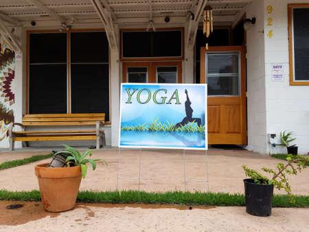 Honolulu - August 23, 2016:  Yoga sign at Hikina Yoga Studio in Honolulu, Hawaii.