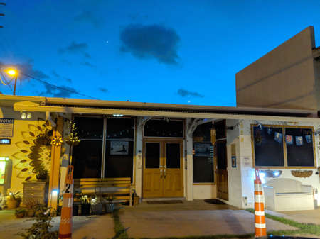 Honolulu - August 12, 2018:  Hikina Yoga Studio with moon crest overhead in the evening in Honolulu, Hawaii.
