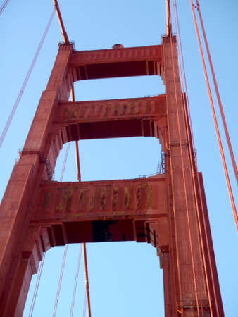 Upward perspective of Art Deco Tower and supporting cables on the Golden Gate Bridge.