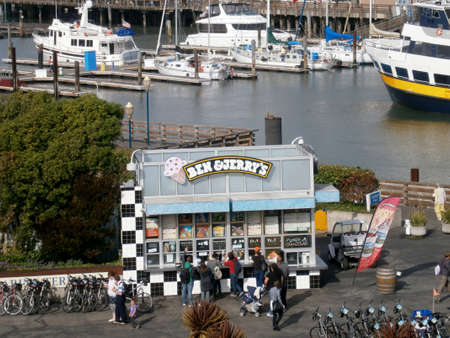 San Francisco - October 24, 2011: People order Ben & Jerry's ice cream along the waterfront, which is an iconic Vermont-based ice cream parlor chain, known for its creative, cleverly named flavors.