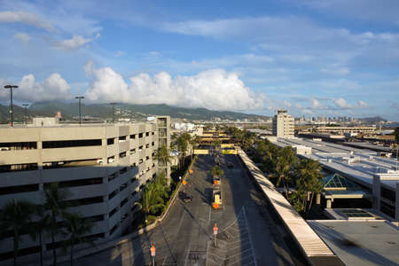 Honolulu - October 3, 2014: Aerial view of Parking lot, Terminal, and Roads leading into Airport at the Honolulu International Airport on a cloudy day, HNL, next to the water on Oahu, Hawaii.