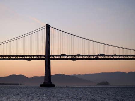 San Francisco side of Bay Bridge with Alcatraz in the distance at dawn. Stok Fotoğraf