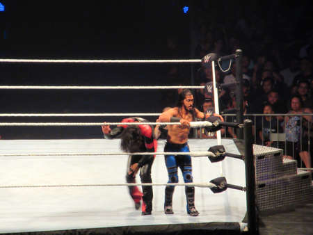 Honolulu - September 22, 2019: WWE Wrestler Ali prepares to use the ropes as Shinsuke Nakamura kneels over in ring during match at WWE event at the Neal S. Blaisdell Center, Honolulu. Editorial