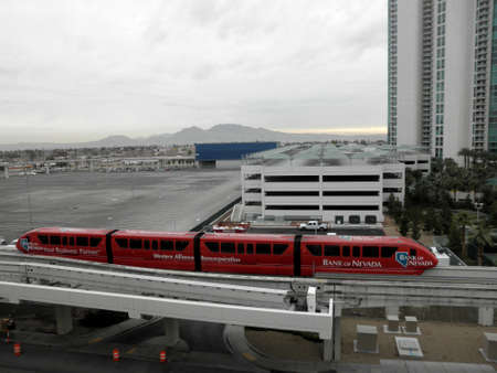 Las Vegas -  February 8, 2010:  Bank of Nevada Monorail Train rides down track on a cloudy day.