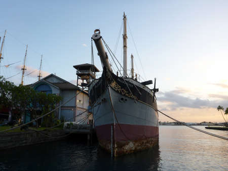 Historic Falls of Clyde Ship sits in Honolulu Harbor at dusk. Falls of Clyde is the last surviving iron-hulled, four-masted full rigged ship, and the only remaining sail-driven oil tanker. Designated a U.S. National Historic Landmark in 1989