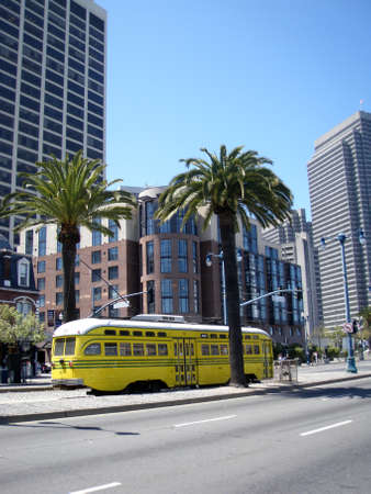 San Francisco - April 24, 2009: Yellow historic streetcar of the F-Line MUNI Train No. 1057 This streetcar is painted to honor Cincinnati, which ran PCC streetcars from 1939 to 1951.