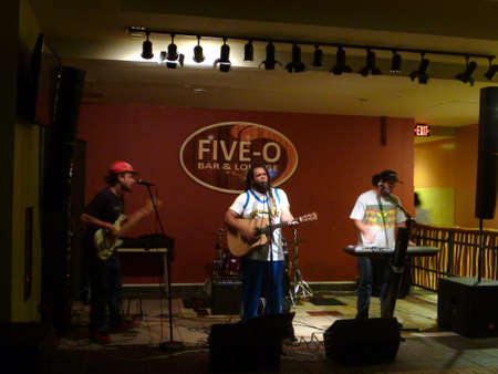 Honolulu - June 13, 2014: Guidance Band, singing and jams on stage at Five-O Bar and Lounge in Waikiki.