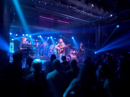 Honolulu - February 22, 2018: Mike Love Band plays music indoors with cool lighting at Crossroads at Hawaiian Brians in Honolulu, Hawaii.