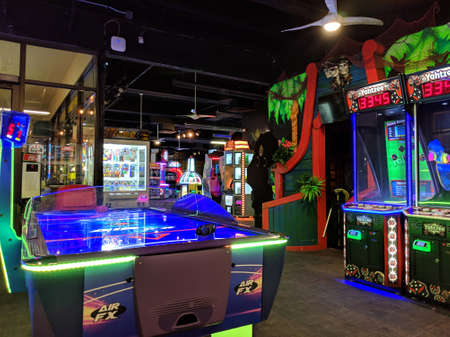 Honolulu -  February 26, 2019: Air Hockey, Yahtzee and Arcade Machines inside Wild Tiki Fun Zone.