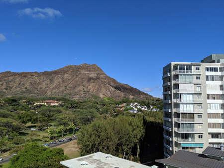 Aerial view of Diamond head and, Kapiolani Park with moon in sky on Oahu, Hawaii.