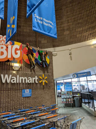 Honolulu - June 22, 2018:  interior of WalMart department store Shopping Carts at entrance. in Honolulu, USA on July 1,2014. WalMart is world third largest public corporation according to Fortune Global 500 in 2012 Redactioneel