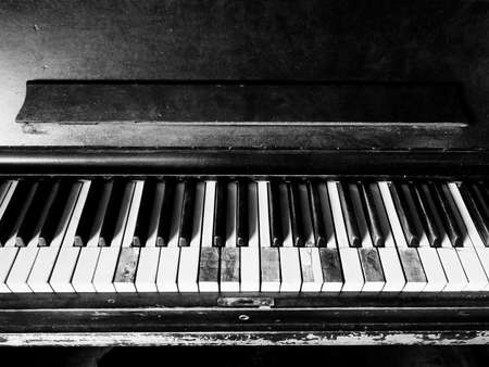 Old, Damaged, Broken, Worn-out Piano Missing Keys