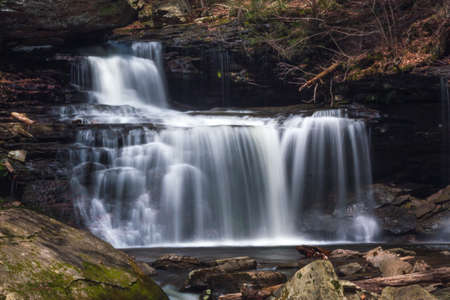 Beautiful Long Exposure Waterfall Cascades Through Rickett's Glen State Park, Pennsylvania, United States of America