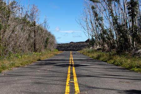 Fresh Lava From The 2018 Kilauea Eruption Covers The Road In Leilani Estates, Big Island Of Hawaii, USA