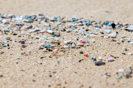 Micro Plastics Washing Ashore On The Beach In Hawaii, USA Stock Photo