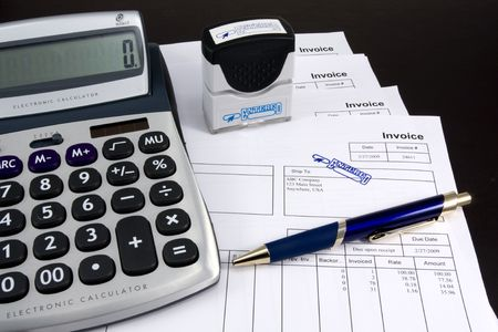 payable: Entered Invoice with Stamp, Calculator and Pen Stock Photo