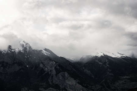 swiss alps: Clouds Over Swiss Alps Stock Photo