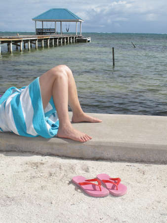 Relaxing on the concrete sea wall with Pink Sandals