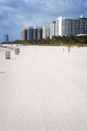 Exercising along South Beach Stock Photo