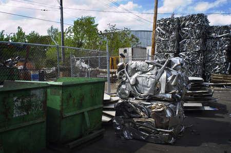 Scrap Aluminum Bales and Dumpsters Stock Photo