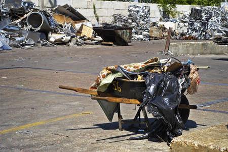 Wheelbarrow with Recycling Scrap Stock Photo - 7112767