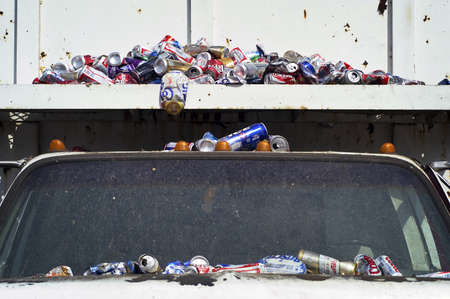 Aluminum Cans Covering a White Truck Stock Photo - 7112758