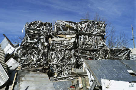 Aluminum Scrap in Cubes Stacked Sky High Stock Photo - 7112770