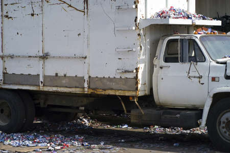 Aluminum Cans Cover the Ground & White Truck Stock Photo - 7112762