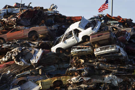 American Flag over Crushed Car Mountain photo