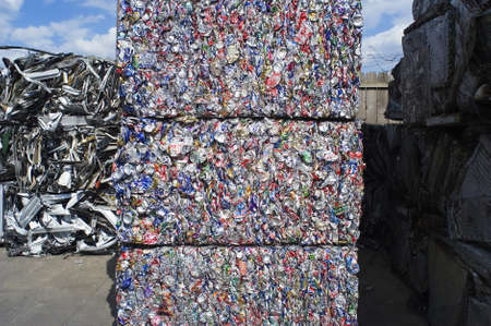 plastic recycling: 3 Stacked Bales of Crushed Aluminum Cans ready for Recycling Stock Photo