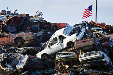 discarded metal: American Flag over Crushed Car Mountain