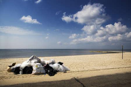 Trash Piled on an Empty Beach, Gulf Coast