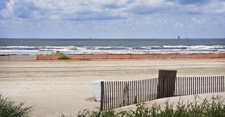 Closed Beach & Oil Rigs, Gulf Coast Stock Photo