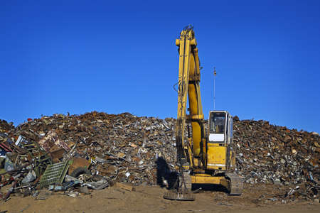 Yellow Crane and Giant Pile of Scrap Metal Stock Photo - 8396740