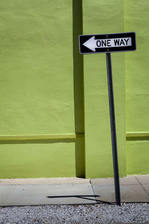 One Way Sign   Green Wall Stock Photo