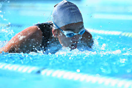 swimmer athlete in butterfly training in the pool. professional swimmer, narrow focus,
