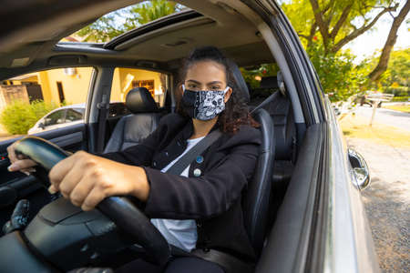 Woman driving with a mask during covid-19