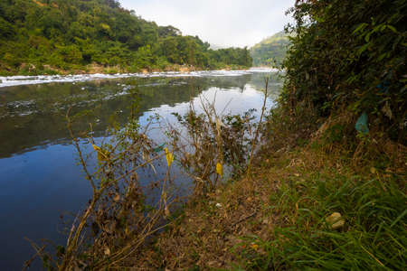 polluted Tiete river on the park road, environmental preservation area, Itu, Sao Paulo, Brazil
