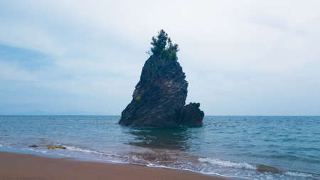 Seen from the shore rock formation surrounded by sea water at Putsan Tiwi Albay