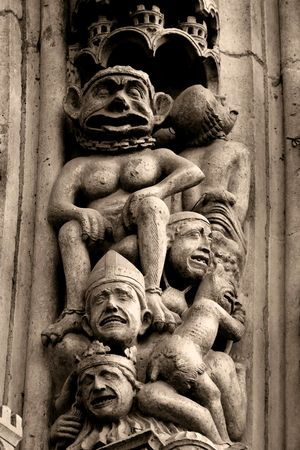 Stone statues on the front porch of Notre-Dame cathedral - Paris, France Stock Photo - 357109